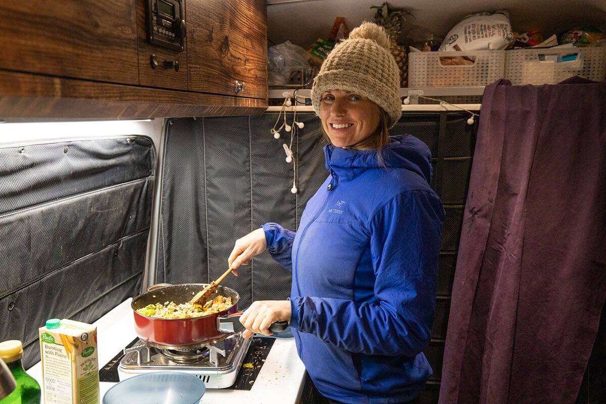This van life cooking guide shares tips for making easy meals in a camper van including how to plan, save money, and make doing dishes easy.