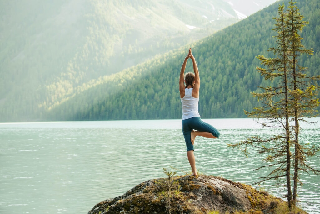 Yoga outside // If you're planning on thru hiking, learn how to train for a thru hike mentally and physically with these tips from PCT and JMT thru hikers.