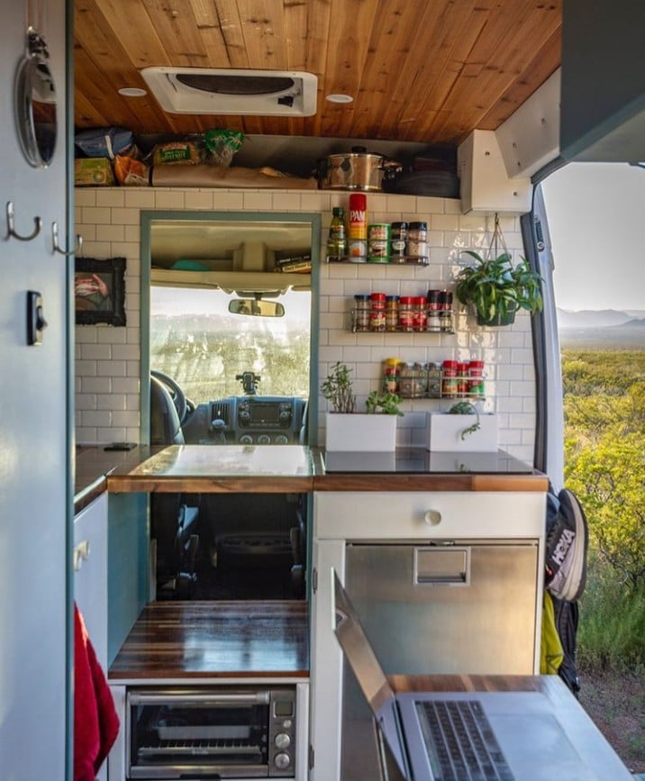 Camper van kitchen by @threevancats / Check out these van galleys for ideas on layout, appliances, storage, and more.