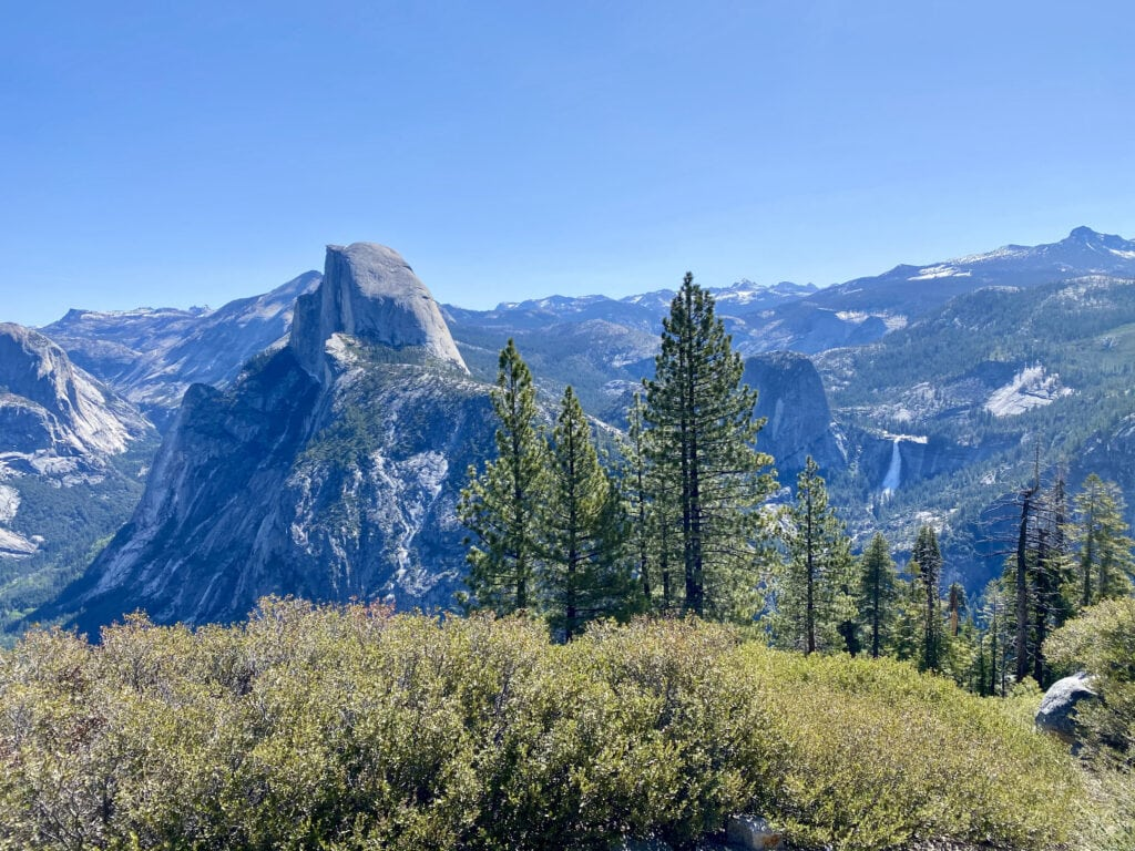 Overlooking Half Dome and Nevada Falls, Yosemite National Park // Looking for the best things to do in Yosemite National Park? Our guide covers Yosemite camping, hiking, & everything else you need to know.