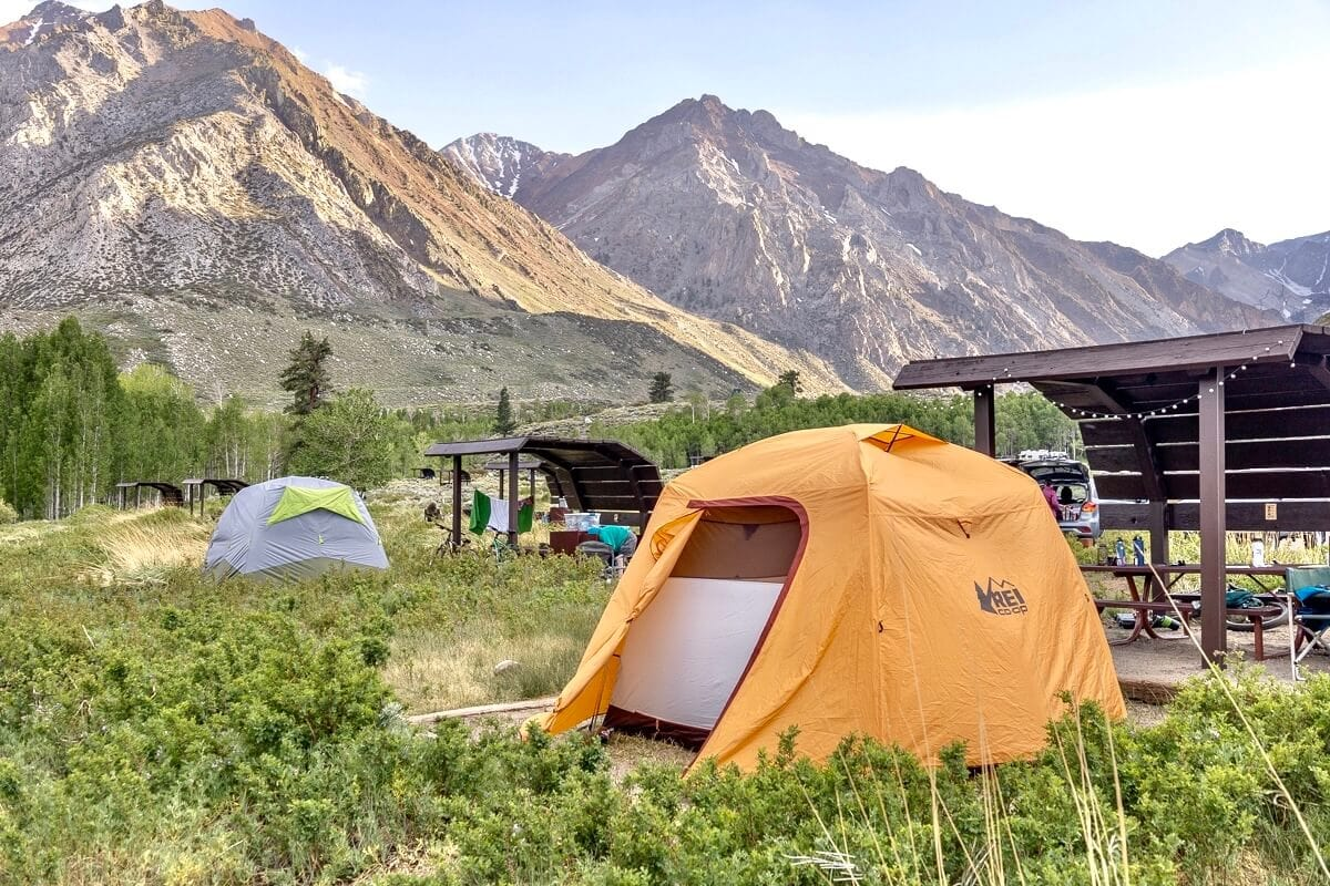 Tents camping at McGee Creek / Check out the best deals on our favorite outdoor gear and clothing and save big during the REI Labor Day Sale with discounts up to 25% off!