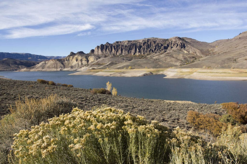 Blue Mesa Reservoir // Discover the best places to SUP in Colorado this summer with the best Rocky Mountain views, calm waters, and quiet solitude.