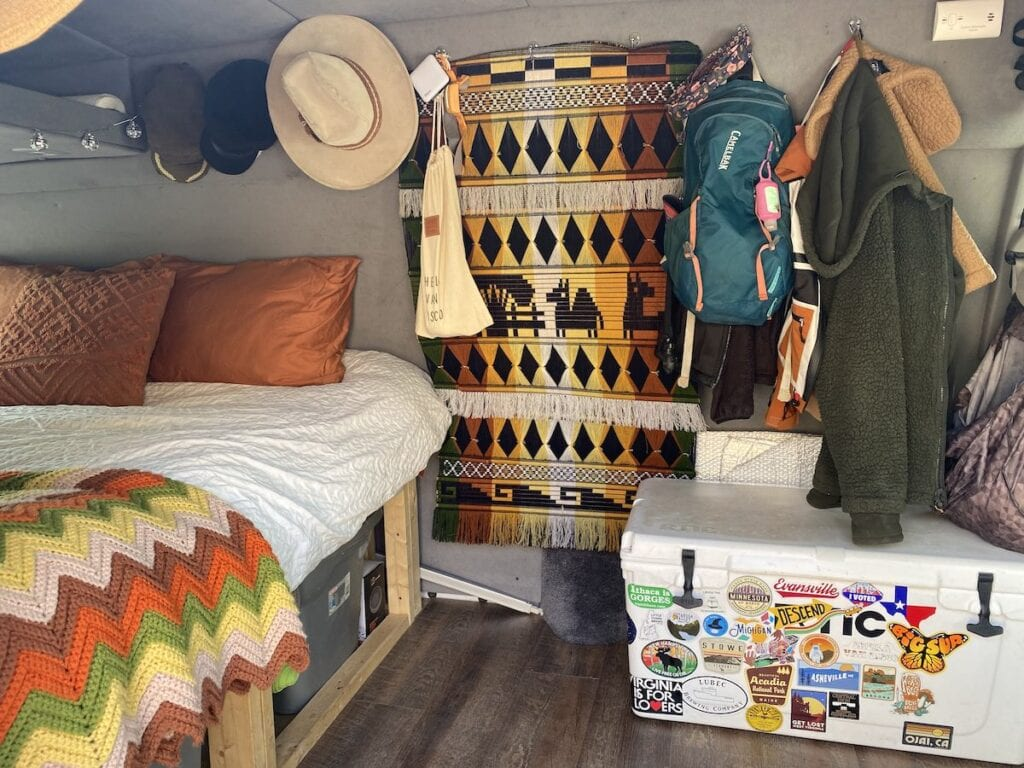 Interior of a Ford Econoline Camper Van // Learn how to save money on your DIY camper van build with 5 easy tips from how to choose a used van to how to do a cheap van conversion.