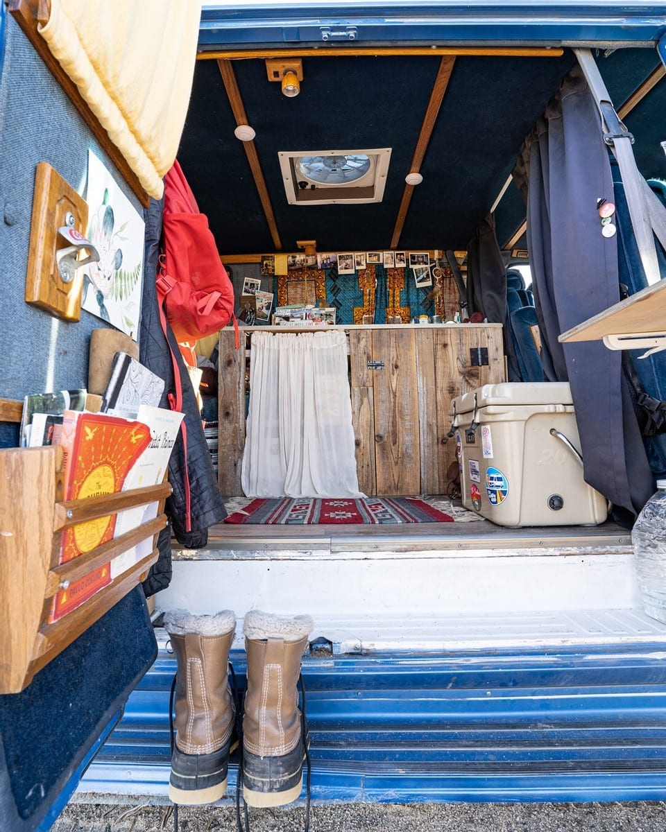 Interior of a Chevy G20 Camper Van // Learn how to save money on your DIY camper van build with 5 easy tips from how to choose a used van to how to do a cheap van conversion.
