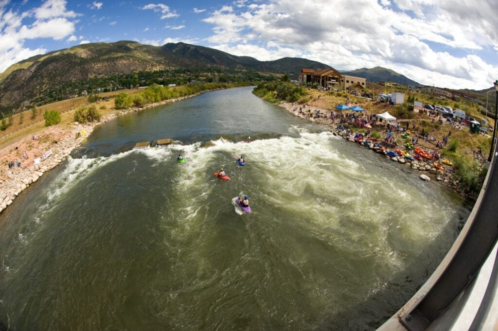 Glenwood Whitewater Park // Discover the best places to SUP in Colorado this summer with the best Rocky Mountain views, calm waters, and quiet solitude.