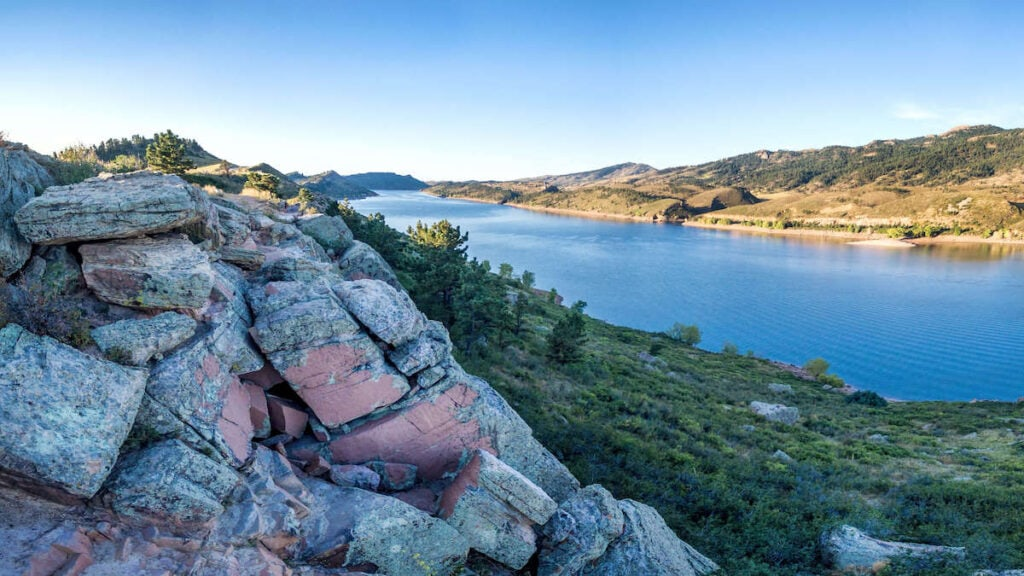 Horsetooth Reservoir // Discover the best places to SUP in Colorado this summer with the best Rocky Mountain views, calm waters, and quiet solitude.