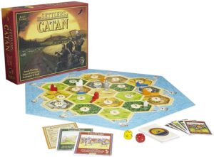 Settlers of Catan // Check out our list of 15 fun, lightweight, and packable camping games that can be played in your tent, car, or around the fire.