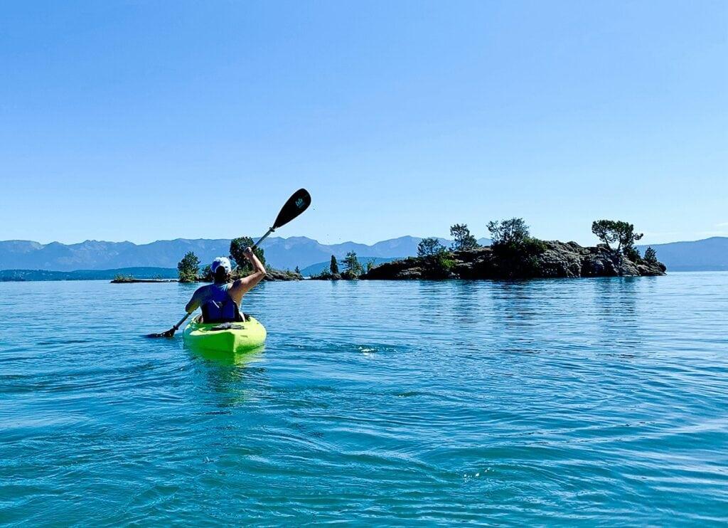 Kintla Lake / Learn the best kayak camping tips for beginners including essential kayak camping gear, how to pack a kayak, tips for buying a kayak, & more.