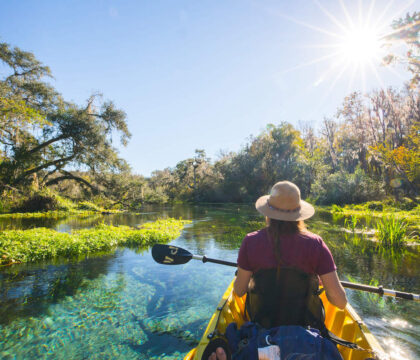 Learn the best kayak camping tips for beginners including essential kayak camping gear, how to pack a kayak, tips for buying a kayak, & more