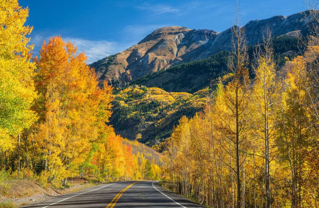 Drive Colorado's Million Dollar Highway and San Juan Skyway to see amazing views of the Rocky Mountains and visit small mountain towns.